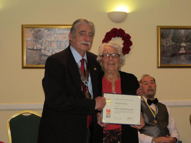 Three Sandown Rotarians awarded Paul Harris Fellows - Peggy Jarman is the first to be surprised!