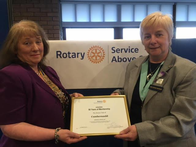 District Governor Olive Geddes presenting a Rotary Award Certificate to President Elizabeth Robertson.