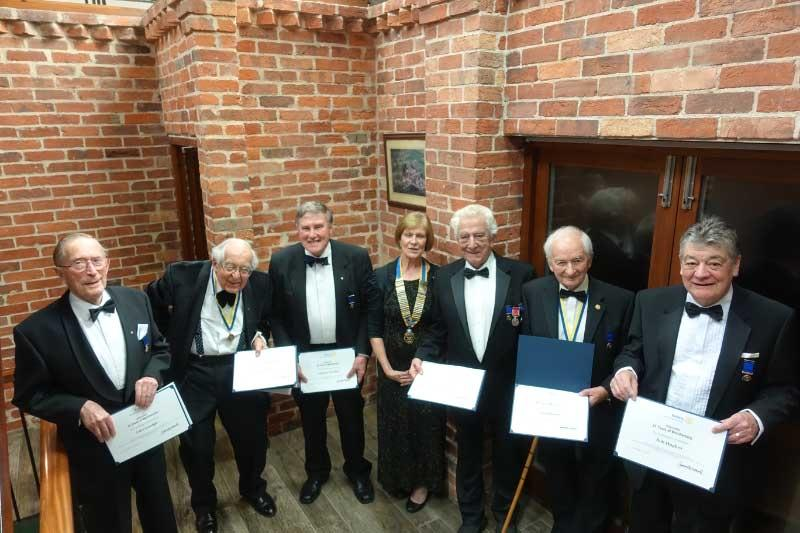 President Chris Bailey (centre) presenting cheques to Southend Blind Welfare, Southend Rotary Club, Southend University Hospital, The Dove Project, Havens Hospices and Harp (Left to Right)