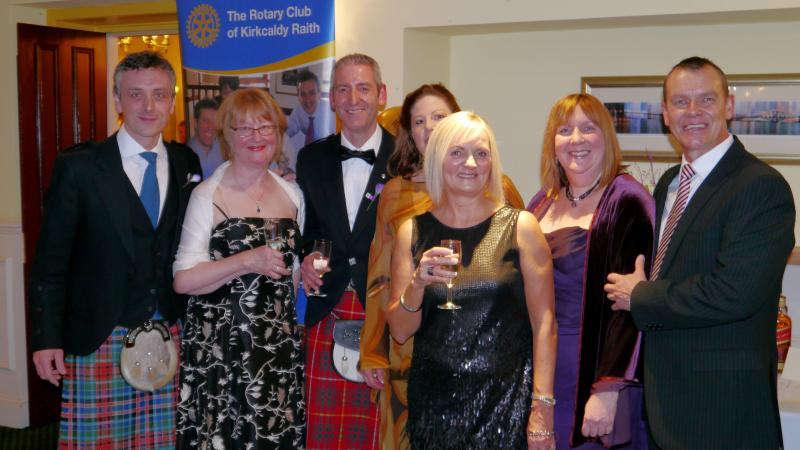 Members of the club greet the guests at the annual Charity Dinner Dance