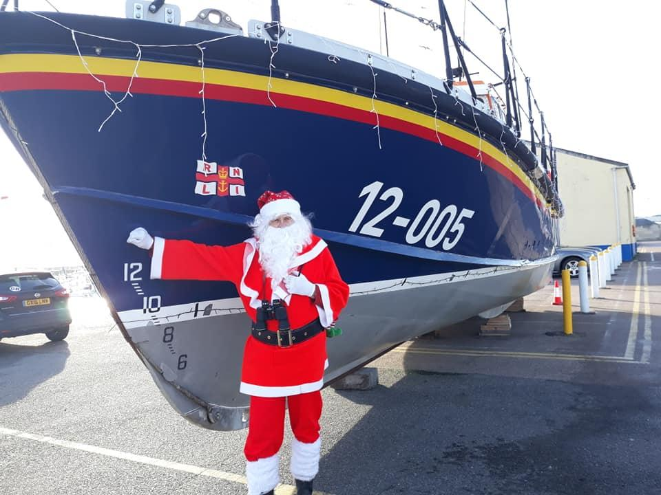 Pop-Up Santa's Christmas journey - day 16 - Here is our daring-do Pop-Up Santa beside his favourite ship in Ramsgate harbour. The lifeboat. He's already had some fun on this in the past. (See earlier post).
