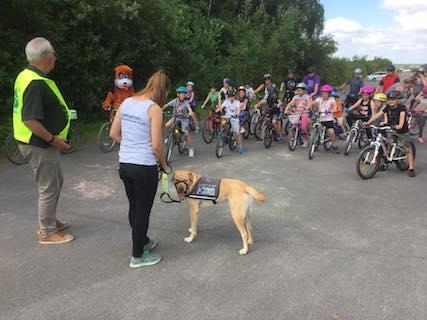 Scoobie starts the event by barking on command - a clever dog!