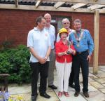 Mills Meadow Garden Project -  Elsie, shows the Cup to Ian Thomson, RIBI President.