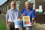 President Ian Haigh (L) and Mike Griffiths take time out from their LifeLine preparations to donate to the MAA Cash4Coins Appeal