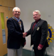 A relieved Immediate Past President, Paul, hands over to a still smiling President John