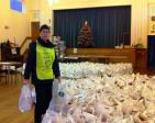 Rotarian Eddie Webb in a sea of  NWN Over 80's Xmas parcels