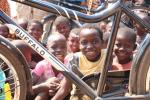 Pictures of some chiildren in Chilaweni, Malawi.  They are looking through the frame of a bicycle ambulance.