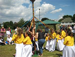 The May Queen and her dancers entertain the crowds at the annual Chislehurst Summer Fair
