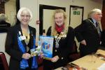 District Governor Carol Reilly Congratulates Eccleshall President Sylvia Keris on the Club's achievements. Rotarian Cllr Brian Price, Deputy Mayor of Stafford in the background