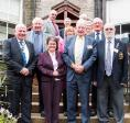 From left, President Bill Knox, New member Branwen Rees, Past President Mike Kimpton and DG Andy Lees with District International Convenor Iain Barr and some members of Greenock Rotary