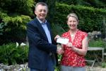 Rotarian Laurence Kettle presents the cheque to Kathy Miller