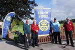 After yesterday's deluge and course closure, all is well for the annual fund raising golf event. Here, Rotary team David Harle, Malcolm Boyd Nick Capron and Alex Buchan pause on their way to the first tee. As it says on the flag New Members are Welco