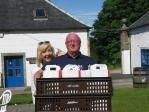 President Anne and Past President Kenny deliver lunch for the hungry pupils.