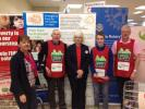 Maureen Reynel from FIND with Mandy Lloyd from Tesco and Rotary Supporters.