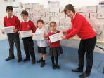 President Kath Nurse receiving shoexes from Falkland School pupils