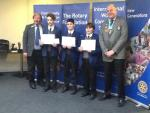 Photograph shows the Norwich school Intermediate team, with Rotarian John Hunting and District Governor Nick Corke