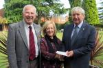 Peter Hill makes sure Mike Griffiths hands over the Carers 4 All cheque to Jill Livingstone