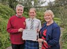President John Stirling and Youth Activities Convenor Aileen North presented Kirsten with her Certificat   Delivre