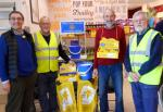 President John and Rotarian Hywel about to take over the collection rota from Rotarians Bryn and Tim