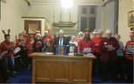 Members of Greenock Rotary with friends and family performed a range of  Carols for the residents of the Mariner's Home