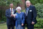 Mary Hansford (Parkinsons UK (Newbury Support Branch) tonight receiving a cheque for £500 from President Hemant with Rotarian Trevor Gibbons
