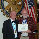 "President Philip receives a ""birthday card"" from District Governor Ken Boylett."