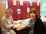 Sarah White - volunteer nurse - taking the blood pressure.