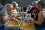 Volunteers packing 100,000 meals at our Stop Hunger Now event