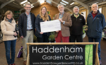 Haddenham Garden Centre Kate Hawkins presents to Rotary President Martin Andrew a £5100 'Santa' boost for Rotary charities
