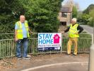 The Club erect Stay at Home signs -