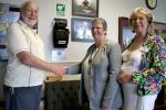 DO WE REALLY MAKE A DIFFERENCE? - Defibrillator being presented for siting at Moor Lane Sports Centre