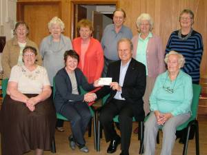 Cheque presentation to the Raffles Group charity