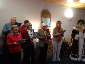 Carol singing Rotarians and partners