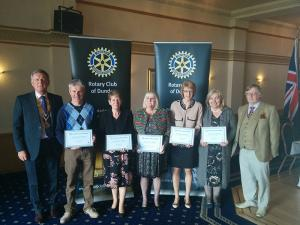 Left to right Robert Dunn, club president; Ricky McKell, Eagles Wings; Frances Parry, Cornerstone; Katrina Saunders, Cairn Fowk; Judy McGreal, Brae Riding; Tina Brown (for Linda Falconer), Dundee Food Bank, and John Irvine, club community service convener