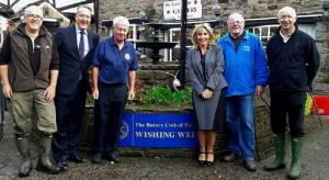 Rotarians clean up at the well