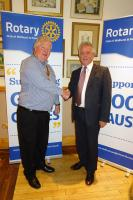 President Robert Morrison  with new Rotarian John Maguire