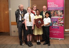Last year's RBWM Mayor John Lenton & Mayoress Margaret Lenton, Maidenhead Thames Rotary President Brian McGinley and the winning Year 4 Mathemagicians from All Saints CoE Primary School holding the winning shield.