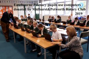 Easebourne Primary pupils with new computers