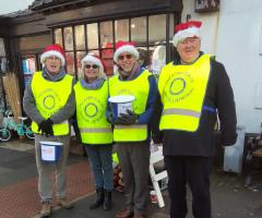 Rotarians collecting on Christmas Eve
