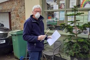John Davies Treks To Trefonen Post Office to Post the Final Tree of Light Cheques