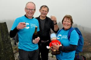 Bill Honeywell, Bill Birkett and Val Honeywell celebrating reaching the 542nd summit in 2016