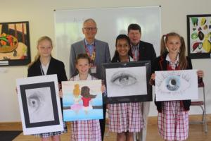 Pupils from Pipers Corner School, Great Kingshill display their winning artwork with President David Bevan and fellow Rotarian Andrew Warren.