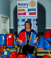 President Rhona Somerville with some of the filled back packs.