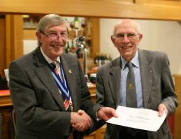 Brian Whitaker receives cerificate from PDG Rod Walmsley