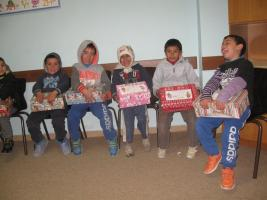 Children receiving their Guernsey Shoe boxes