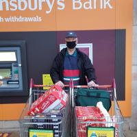 Matlock Rotary's John Bent with the Food Purchased from Sainsbury's for the Hampers