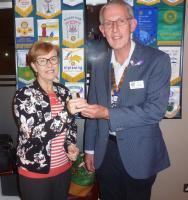 President Colin Dowding presenting Margaret Butt with her purple crocus