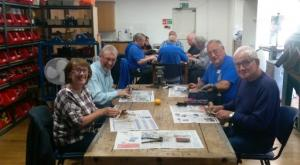 Barton le Clay Rotarians trying their hands at tool refurbishment.