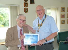 Bert Biggs receiveing his award from President Mike Williams