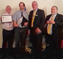 President Roger Sharp with Chris Day on his right and Mark Tarsey and Graham Bourne on his left respectively.